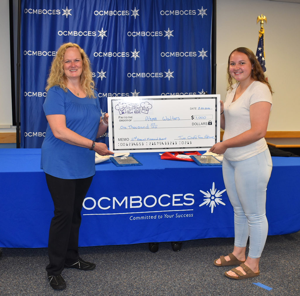 Nancy Chappell presents another $1000 2021 scholarship check to Ahren Walters