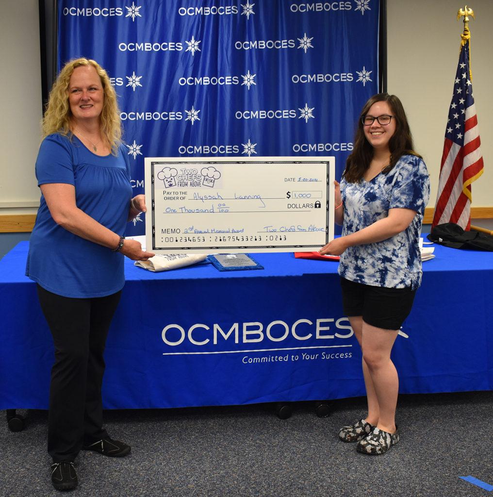 Nancy Chappell presents $1000 scholarship to Ahren Walters